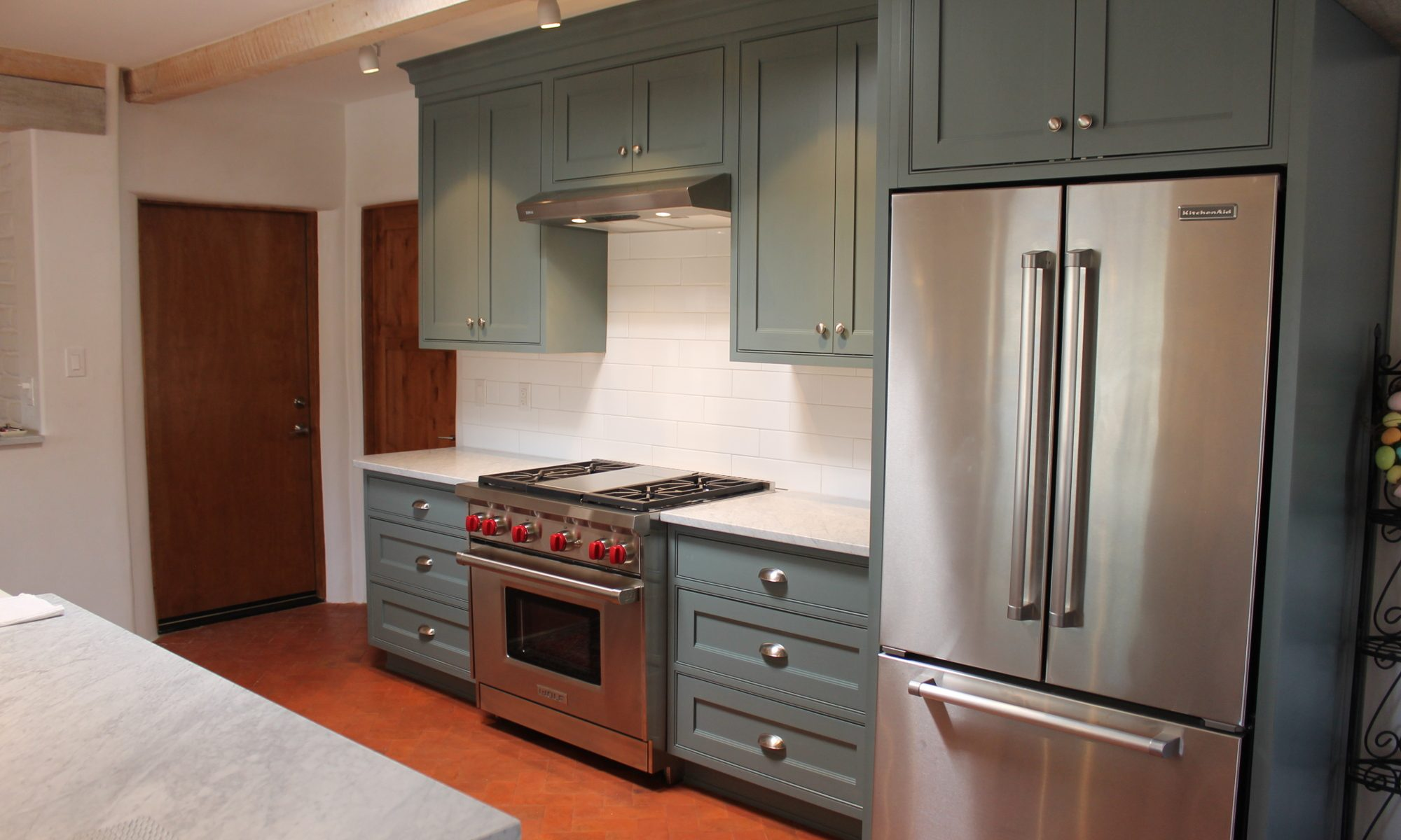 Blue kitchen with stainless steel appliances